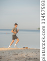 Man running beach 11457593