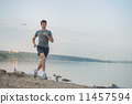 Man running beach 11457594