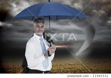 Composite image of stressed businessman with hands on head 11565512