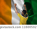 Composite image of cheering football fan in yellow jersey 11600502
