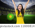 Composite image of excited football fan in brasil tshirt 11600814