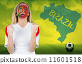 Composite image of excited portugal fan in face paint cheering 11601518