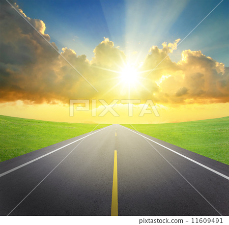 sunrise with asphalt road and green grass 11609491