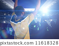 Composite image of cheering football fan in yellow jersey 11618328