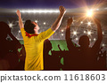 Composite image of cheering football fan in yellow jersey 11618603