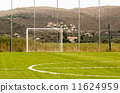 Goal at a small local football field with mountain background 11624959
