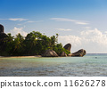 Tropical beach with coconut palm trees at Seychelles 11626278