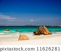 Tropical beach with rocks in the water on Seychelles Islands 11626281