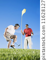 Multi-ethnic men playing golf 11628127
