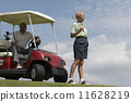 Senior African American couple with golf cart 11628219