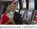Hispanic couple holding money 11628251