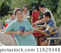 Middle-aged woman smiling for the camera at a barbecue 11629348