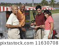 Multi-ethnic couples at food stand on golf course 11630708