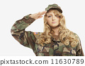 Woman wearing military uniform and saluting 11630789