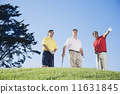 Multi-ethnic men on golf course 11631845