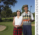 Senior Asian couple smiling on golf course 11632020