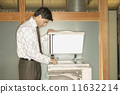 Businessman using copy machine 11632214
