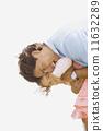 Hispanic father hugging daughter 11632289
