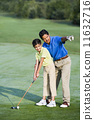 Hispanic father helping daughter play golf 11632716
