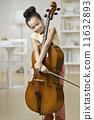 Mixed Race girl holding cello 11632893