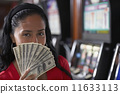 Hispanic woman holding money 11633113