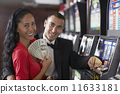 Hispanic couple holding money 11633181