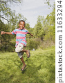 African boy running and jumping in park 11633294