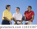 Multi-ethnic men holding golf clubs 11633387