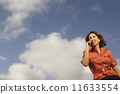 Hispanic woman talking on cell phone 11633554