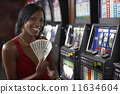 Mixed Race woman holding money 11634604
