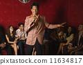 Mixed Race man singing karaoke at nightclub 11634817