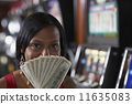 Mixed Race woman holding money 11635083