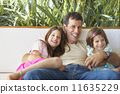 Hispanic father and daughters hugging 11635229