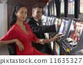 Hispanic couple at slot machines 11635327