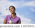 Hispanic woman holding golf club 11635641