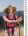 Senior woman hiking 11635773