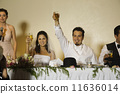 Hispanic newlyweds toasting with champagne 11636014