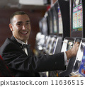 Hispanic man at slot machine 11636515