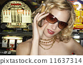 Young woman smoking a cigar in a casino 11637314