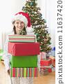 Girl holding presents 11637420