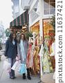 Two women on th sidewalk shopping  11637421