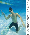Underwater shot of Asian man waving 11637425