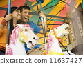 Couple riding a rollercoaster 11637427