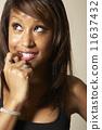 African American woman biting finger 11637432