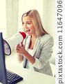 crazy businesswoman shouting in megaphone 11647096