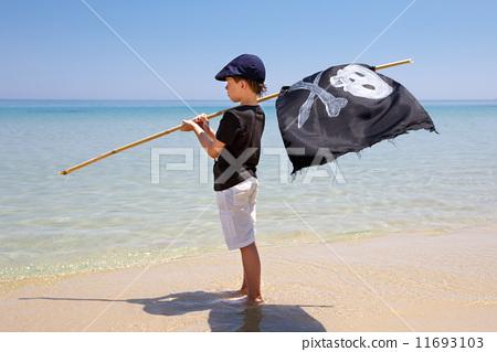 Cute boy dressed as pirate on tropical beach  11693103