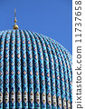 Tiled dome of a mosque with a golden crescent 11737658