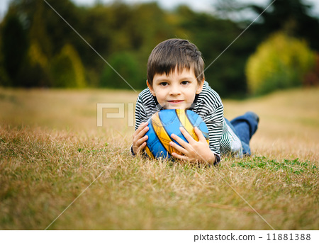 Boy with a ball 11881388