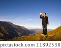 Businessman Shouting on the Top of the Mountain 11892538