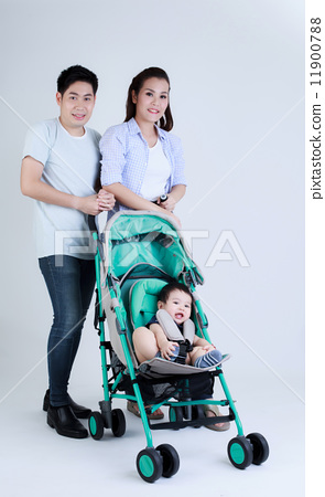 Young Thai dad mom and son in the pram smile happily 11900788